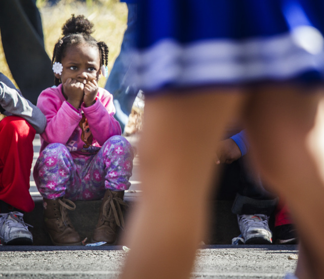 Cookie Morris, 4, watches cheerleaders from the Somerset Academy Monday, January 19 2015 during the 33rd Annual Dr. Martin Luther King Jr. Parade in Downtown Las Vegas. (Jeff Scheid/Las Vegas Revi ...