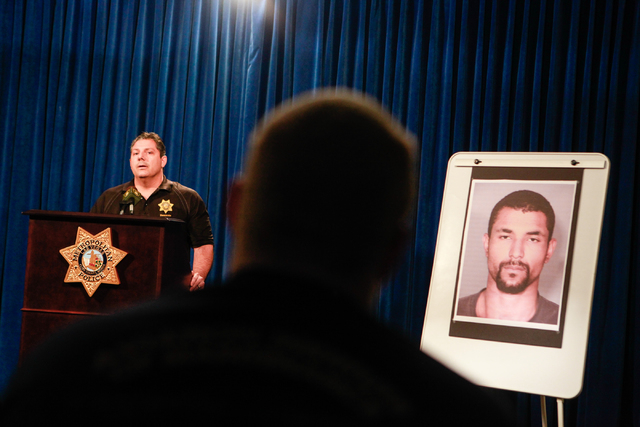 Ryan Young, center, watches as Las Vegas homicide Lt. Ray Steiber speaks about the arrest of Jerry Howard, who allegedly killed Kathy Shines, Young's mother, on Jan. 3, during a press conference a ...