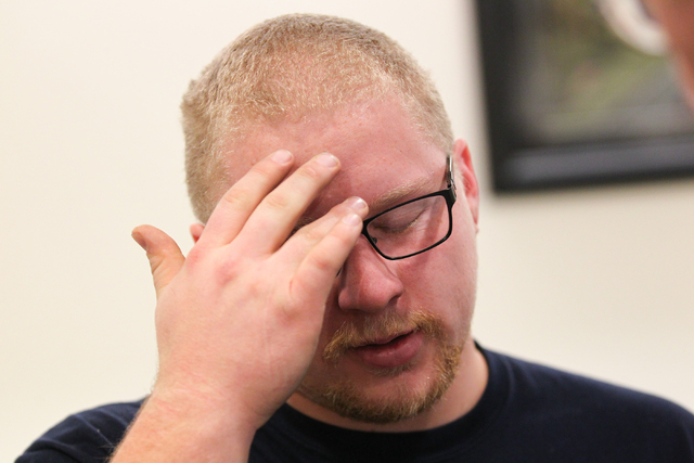Ryan Young reacts while speaking with news media about his mother, Kathy Shines, who was allegedly killed by Jerry Howard on Jan. 3, after a press conference at Metro headquarters  in Las Vegas on ...