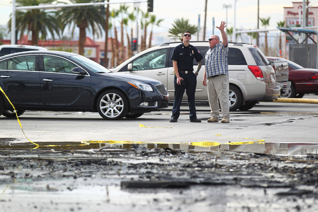North Las Vegas firefighters investigate after responding to a fire that destroyed a marquee at Poker Palace, 2757 Las Vegas Blvd. N, in North Las Vegas on Monday, Jan. 26, 2015. The fire began wh ...