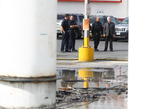 North Las Vegas Fire Department officials and casino staff observe the damage after firefighters responded to a fire that destroyed a marquee at Poker Palace, 2757 Las Vegas Blvd. N, in North Las  ...
