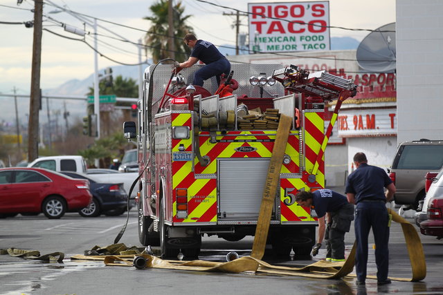 North Las Vegas firefighters clean up after responding to a fire that destroyed a marquee at Poker Palace, 2757 Las Vegas Blvd. N, in North Las Vegas on Monday, Jan. 26, 2015. The fire began when  ...