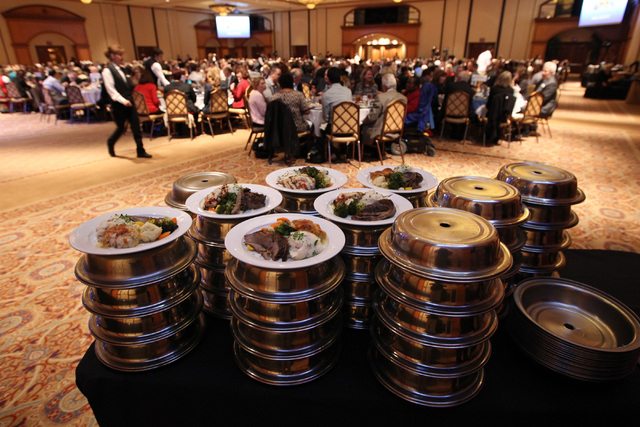 Plates of food wait to be delivered to attendees of the North Las Vegas State of the City address Tuesday, Jan. 27, 2015 at Texas Station. (Sam Morris/Las Vegas Review-Journal)