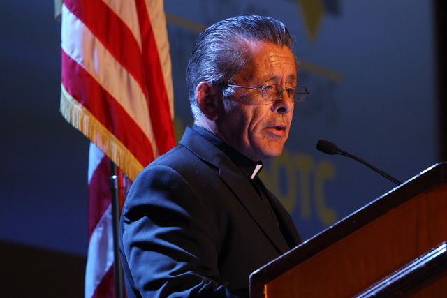 Father Dave Casaleggio gives an invocation before North Las Vegas Mayor John Lee delivers his State of the City address Tuesday, Jan. 27, 2015 at Texas Station. (Sam Morris/Las Vegas Review-Journal)