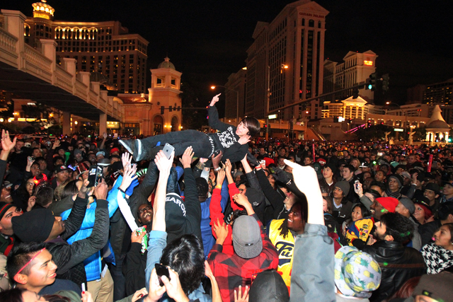A Young Man Crowd Surfs In Front Of Ballys On The Strip In Las Vegas