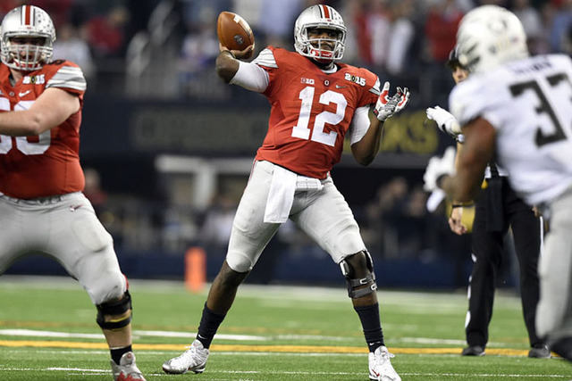 Jan 12, 2015; Arlington, TX, USA; Ohio State Buckeyes quarterback Cardale Jones (12) throws a pass during the fourth quarter against the Oregon Ducks in the 2015 CFP National Championship Game at  ...