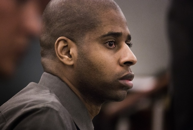 "Markiece Palmer, accused of fatally beating his stepson Roderick ""RJ"" Arrington, during opening statements at Regional Justice Center on Tuesday, Nov.18, 2014.  (Jeff Scheid/Las Vegas Review-Journal)"
