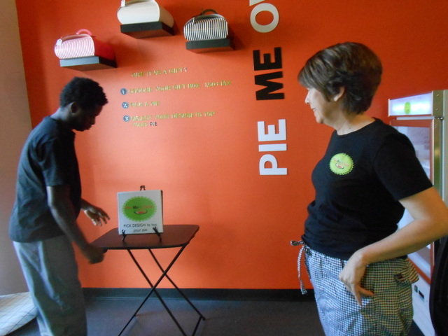 Feliciano Savilengo, left, works on a display at Pie Me Over Nov. 14, 2014, while co-owner Marje Hammond watches. The new business had a following in Boston, from which the owners hail. (Jan Hogan ...