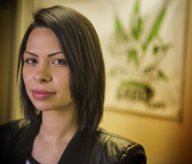 Andrea Carrillo, who plans to apply for a medical marijuana card, stands of a photoThursday, Jan. 8,2015  at Wellness Education Cannabis Advocates of Nevada, 1771 E. Flamingo. More than 8,000 Neva ...