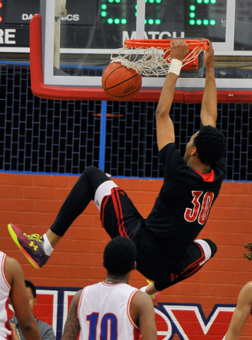 Las Vegas' Tyler Bey (30) makes a dunk against Valley during a high school basketball game at Valley High School on Tuesday, Jan. 20, 2015. (David Becker/Las Vegas Review-Journal)