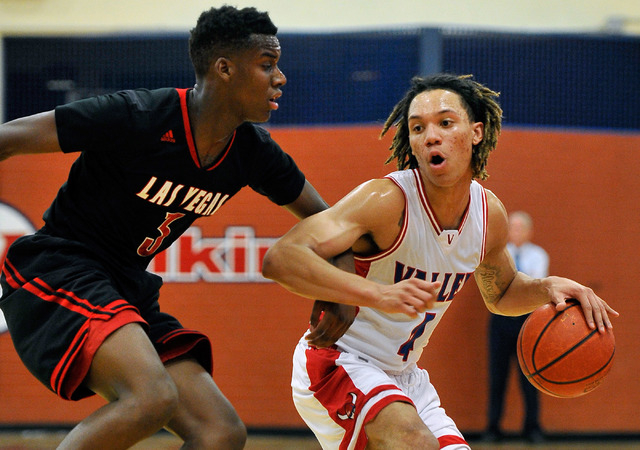 Valley's Taveon Jackson, right, brings the ball down court against Las Vegas' Tyshon Raybon during a high school basketball game at Valley High School on Tuesday, Jan. 20, 2015. (David Becker/Las  ...