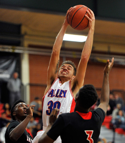 Valley's Brendan Orphan (30) grabs a rebound against Las Vegas' Will Loche, left, and Tyshon Raybon during a high school basketball game at Valley High School on Tuesday, Jan. 20, 2015. (David Bec ...
