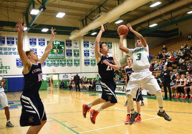 Green Valley's Kelvin Omojola (3) shoots the ball over Coronado's Andrew Palma (21) on Wednesday. Coronado won, 72-47. (Martin S. Fuentes/Las Vegas Review-Journal)