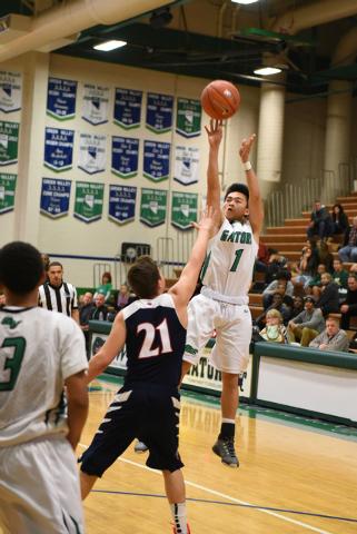 Green Valley's Kris Nicholas (1) shoots the ball over Coronado's Andrew Palma (21) on Wednesday. Coronado won, 72-47. (Martin S. Fuentes/Las Vegas Review-Journal)