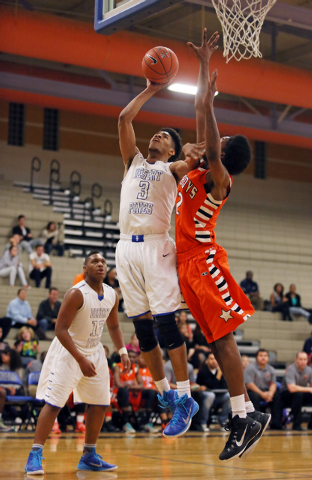 Desert Pines' Trevon Abdullah, center, goes for a layup against Chaparral's Maharie Trotter on Wednesday. Abdullah had 25 points and 17 rebounds in a 67-59 Desert Pines win. (Ronda Churchill/Las V ...