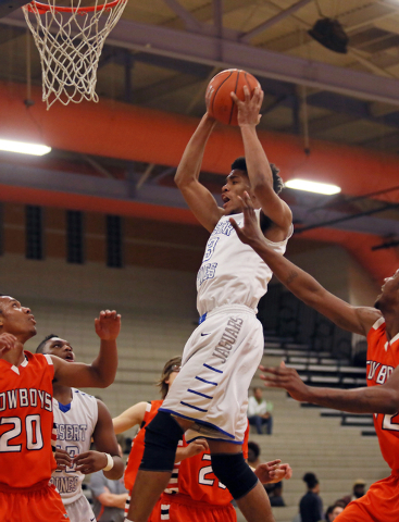 Desert Pines' Trevon Abdullah, center, goes up for a rebound during a game against Chaparral on Wednesday. Abdullah had 25 points and 17 rebounds in a 67-59 win. (Ronda Churchill/Las Vegas Revie ...