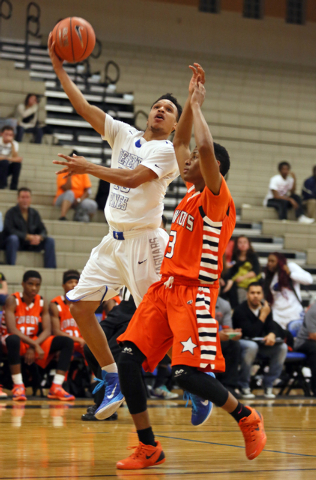 Desert Pines' Coby Myles, left, goes for a layup past Chaparral's Marc Silas on Wednesday. Desert Pines won, 67-59. (Ronda Churchill/Las Vegas Review-Journal)