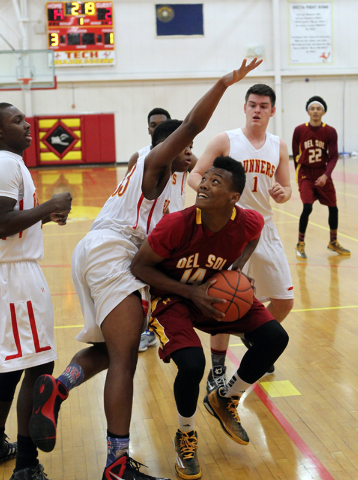 Del Sol forward Brian Greer (14) looks to shoot past Southeast Career Tech forward Sir-Isak Sigleton (33) on Wednesday. Greer averages 16.7 points, 5.5 rebounds and 2.5 blocked shots. (K.M. Cannon ...