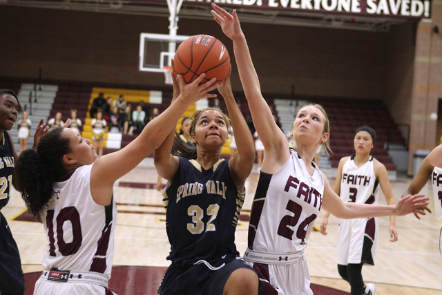 Faith Lutheran guard Kim Munro, left and forward Morgan Hill defend Spring Valley forward Lynnae Wilds on Tuesday. Spring Valley won, 63-54. (Sam Morris/Las Vegas Review-Journal)