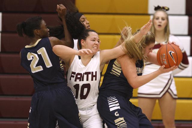 Spring Valley forward Jessica Rafay grabs a rebound away from Faith Lutheran guard Kim Munro on Tuesday. Rafay had eight rebounds as Spring Valley won, 63-54. (Sam Morris/Las Vegas Review-Journal)