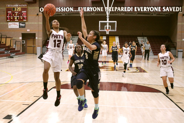 Faith Lutheran guard Haley Vinson is defended by Spring Valley guard Bria Hardin-Davidson on a fast break on Tuesday. Vinson had 12 points, but Spring Valley won, 63-54. (Sam Morris/Las Vegas Revi ...