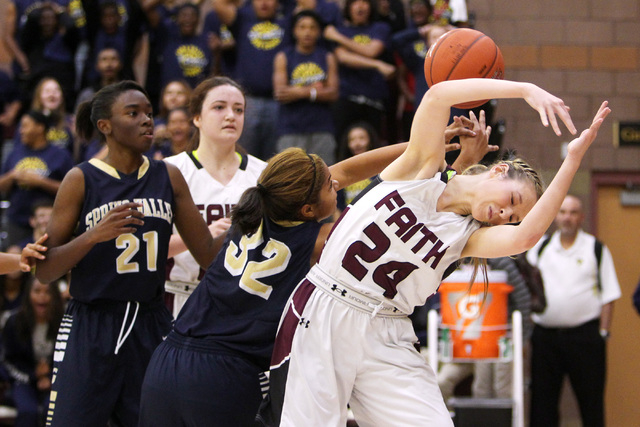 Spring Valley forward Lynnae Wilds and Faith Lutheran forward Morgan Hill both lose control of a rebound on Tuesday. Spring Valley won, 63-54. (Sam Morris/Las Vegas Review-Journal)