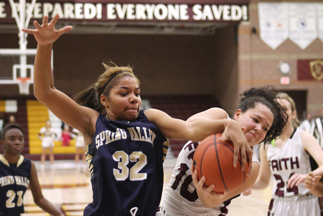 Spring Valley forward Lynnae Wilds and Faith Lutheran guard Kim Munro fight for a rebound on Tuesday. Wilds had six rebounds as Spring Valley won, 63-54. (Sam Morris/Las Vegas Review-Journal)