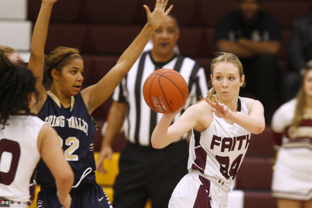 Faith Lutheran forward Morgan Hill passes the ball while being defended by Spring Valley forward Lynnae Wilds o Tuesday. Hill scored 20 points, but Spring Valley won, 63-54. (Sam Morris/Las Vegas  ...