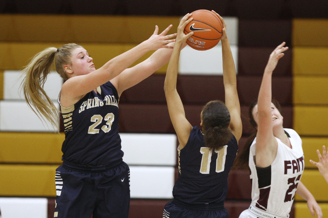 Spring Valley forward Jessica Rafay, left, and guard Kayla Harris battle for a rebound with Faith Lutheran forward Bryanna Neagle on Tuesday. Spring Valley won, 63-54. (Sam Morris/Las Vegas Review ...
