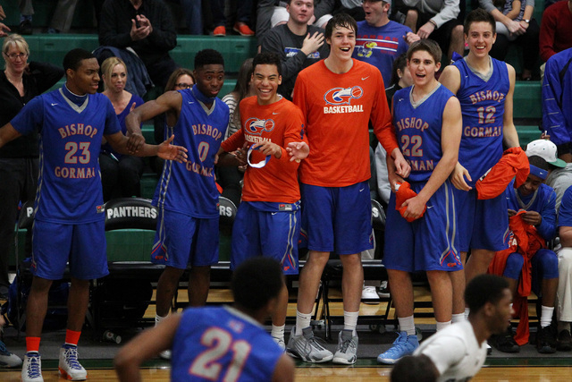 Bishop Gorman players celebrate a dunk by forward Deon Whiteside to finish their game against Palo Verde Thursday, Jan. 8, 2015, at Palo Verde. Bishop Gorman won the game 88-63. (Sam Morris/Las Ve ...