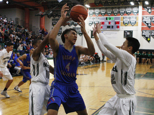 Bishop Gorman center Chase Jeter nearly loses the ball while being double teamed by Palo Verde guards Ja Morgan, left, and Taylor Miller Thursday. Jeter had 15 points and eight rebounds in an 88-6 ...