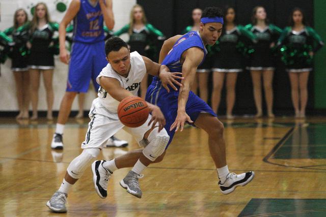 Bishop Gorman guard Richie Thornton strips the ball from Palo Verde guard Graeson Vereen on Thursday. Gorman won the game 88-63. (Sam Morris/Las Vegas Review-Journal)