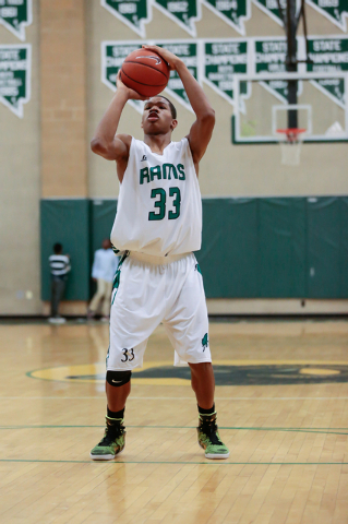 Rancho High School's Lamont Traylor (33) attempts a free-throw after drawing a foul, during a basketball game with Green Valley High School (with a final score of 57 to 53 in favor of Rancho) at R ...