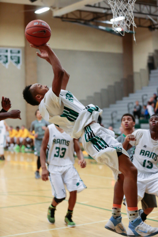 Rancho High School's David McKeever (1) maneuvers up and around to shoot a basket, during a basketball game with Green Valley High School (with a final score of 57 to 53 in favor of Rancho) at Ran ...