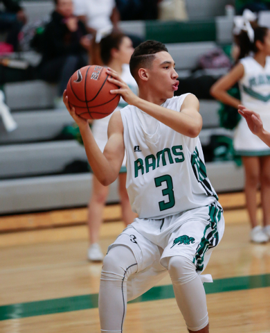 Rancho High School's Chrys Jackson (3) stops to pass the ball to his teammate across the court, during a basketball game with Green Valley High School (with a final score of 57 to 53 in favor of R ...
