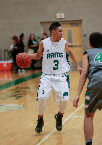 Rancho High School's  Chrys Jackson (3) moves the ball up the court during a basketball game with Green Valley High School (with a final score of 57 to 53 in favor of Rancho) at Rancho High School ...