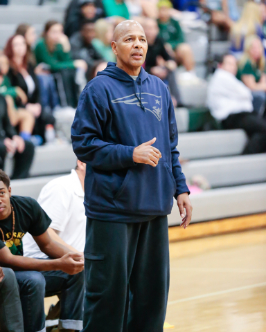 Rancho High School's Coach Ronald Childress watches his players on the court during a basketball game with Green Valley High School (with a final score of 57 to 53 in favor of Rancho) at Rancho Hi ...