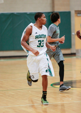 Rancho High School's Lamont Traylor (33) moves down court while watching where the ball and his teammates are at during a basketball game with Green Valley High School (with a final score of 57 to ...