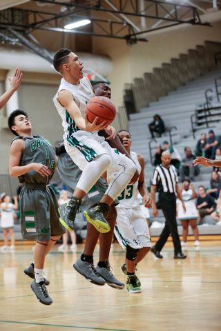 Rancho High School's Chrys Jackson (3) shoots a basket during a basketball game with Green Valley High School at Rancho High School, Las Vegas, Friday, Jan. 09, 2015. Rancho won 57 to 53. (Donavon ...