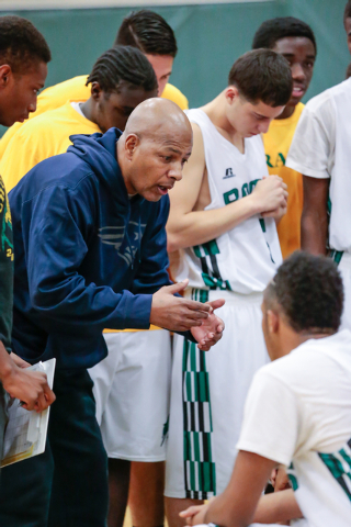 Rancho High School's Coach Ronald Childress, talks with his players during a timeout at a basketball game with Green Valley High School (with a final score of 57 to 53 in favor of Rancho) at Ranch ...