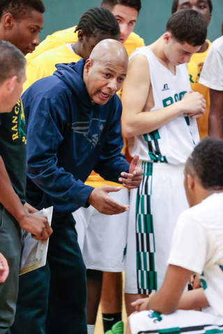 Rancho High School coach Ronald Childress talks with his players during a timeout of a basketball game with Green Valley High School at Rancho High School in North Las Vegas Friday, Jan. 9, 2015.  ...