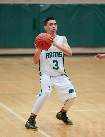 Rancho High School's Chrys Jackson (3) stops and looks for an open teammate to pass the ball to, during a basketball game with Green Valley High School (with a final score of 57 to 53 in favor of  ...