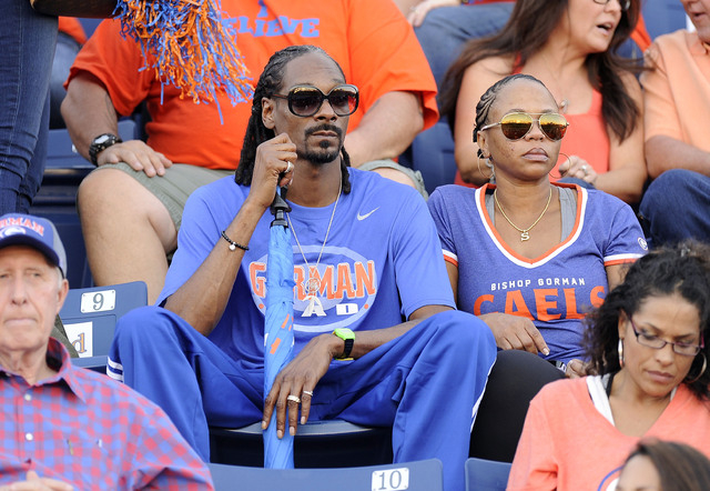 Rapper Snoop Dogg, center, is seen before the start of the Sollenberger Classic High School football game Between Bishop Gorman and Brophy Prep on Friday. Snoop's son, Cordell Broadus, had four re ...