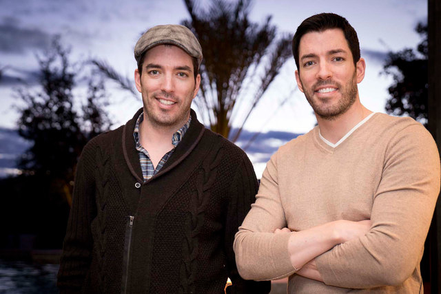 "Jonathan and Drew Scott, who star on the HGTV's ""Property Brothers,"" relax in their Las Vegas home. (Tonya Harvey/Real Estate Millions)"