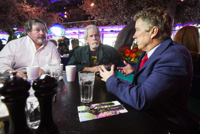 U.S. Sen. Rand Paul, R-Ken.,right,  greets diners Zack Zacharias, left, and Rob Orth Friday, Jan. 16, 2015 at the Peppermill Restaurant, 2985 South Las Vegas Boulevard. (Jeff Scheid/Las Vegas Revi ...
