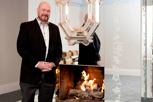 United Kingdom businessman Martyn Ravenhill stands in front of a mirrored fireplace in the master suite of the Liberace's old Las Vegas home, which he purchased for $500,000 in 2013. (Tonya Harvey ...