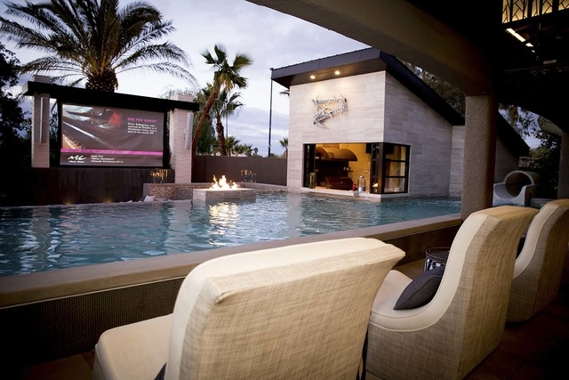 The home's pool area features a 165-inch, 12-foot-wide outdoor movie screen. (Tonya Harvey/Real Estate Millions)