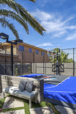 Drew and Jonathan Scott installed a basketball court in the backyard of their Las Vegas home. (Tonya Harvey/Real Estate Millions)
