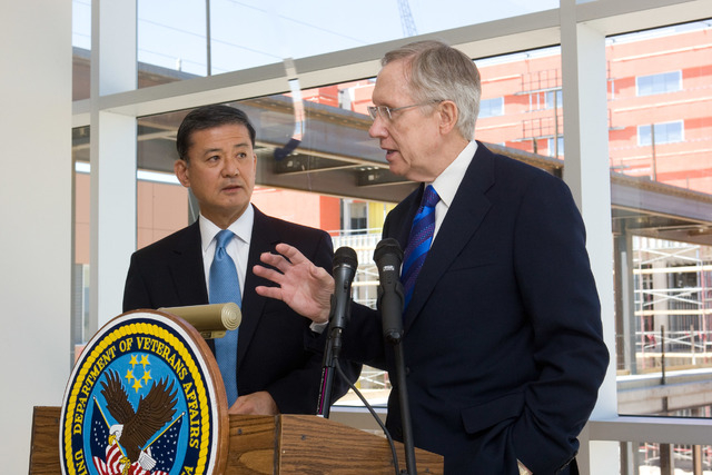 Veterans Affairs Secretary Eric K. Shinseki, left, looks on as Senate Majority Leader Harry Reid, D-Nev., speak to members of the media following a tour of the new VA hospital under construction a ...