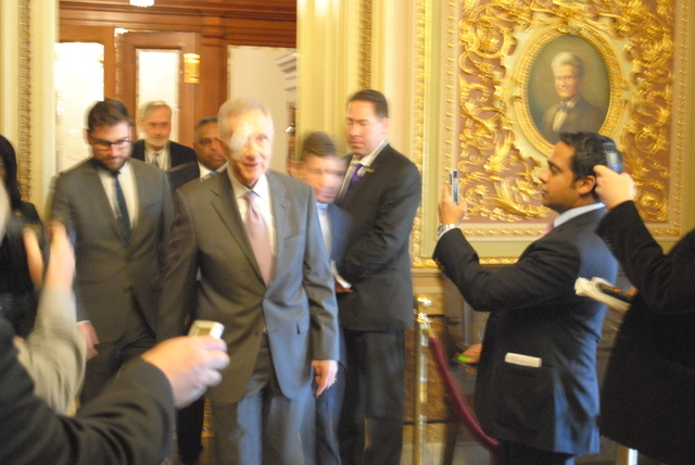 Sen. Harry Reid, D-Nev., center, heads into the Democrats' policy luncheon in the U.S. Capitol on Tuesday, Jan. 20, 2015. It was Reid's first day back in the Capitol after being injured in an exer ...
